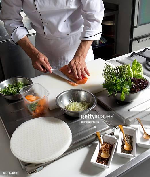Chef Cutting salmon fish in Restaurant Kitchen