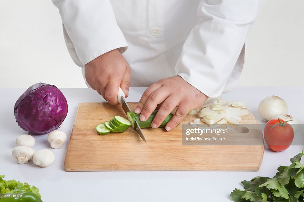 Chef cutting vegetables : Stock Photo