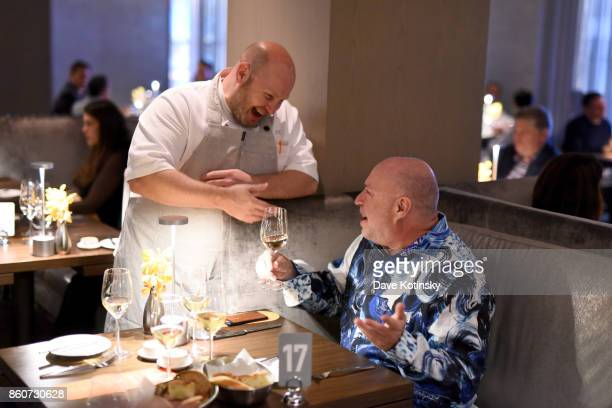 Chef Dan Kluger speaks with a guest during a Dinner with Charlie Palmer Matt Lambert and Dan Kluger part of the Bank of America Dinner Series...