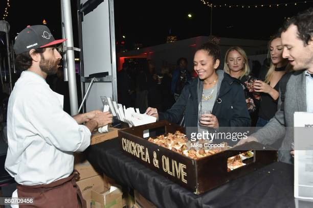 Chef Daniel Strong serves guests at The Food Network & Cooking Channel New York City Wine & Food Festival Presented By Coca-Cola - Smorgasburg...