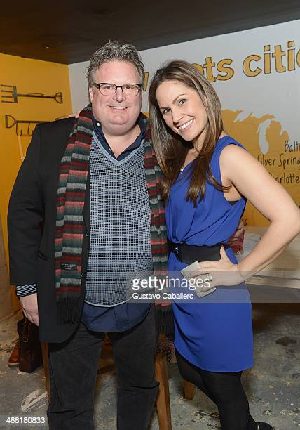 Chef David Burke and Amber Milt attend the IRC New Roots PopUp featuring Chef David Burke on February 9 2014 in New York City