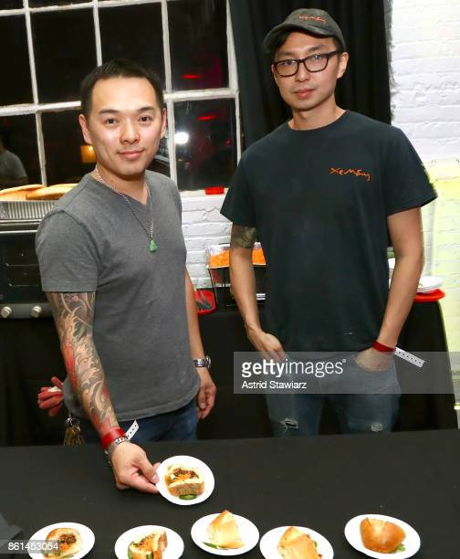Chef Davis Ngo displaying the 'Hog' sandwich and chef Alan Woo attend Street Eats hosted by Ghetto Gastro at Industria on October 14 2017 in New York...