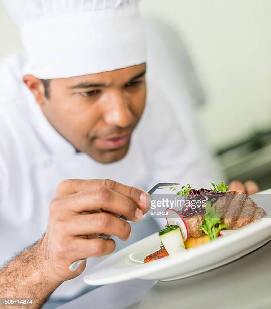 Chef decorating a plate