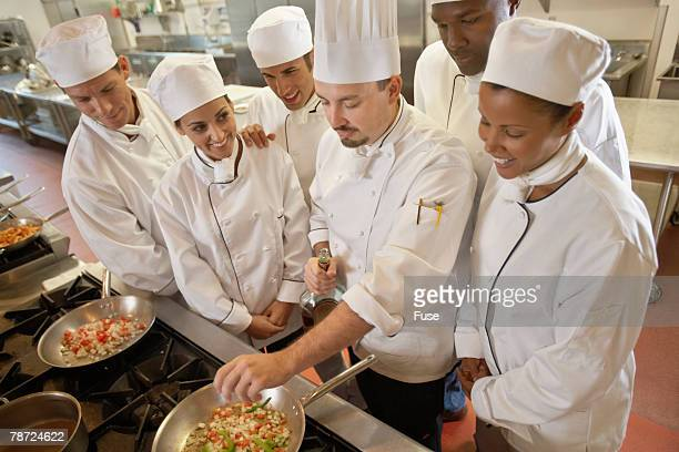 Chef Demonstrating to a Group of Students