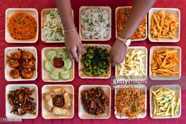 Chef displays the varieties of dishes on offer at a food stall at the 'Bengaluru Aaharotsava', a 3-day vegetarian food festival, in Bangalore on...