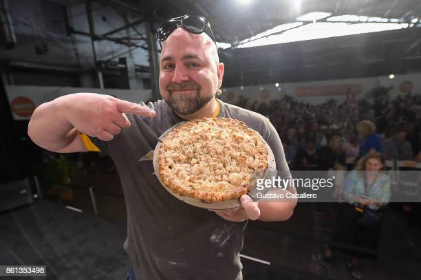 Chef Duff Goldman prepares a dish at the Food Network Cooking Channel New York City Wine Food Festival presented by CocaCola Grand Tasting presented...