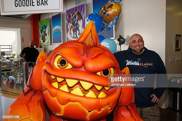 Chef Duff Goldnman and Skylanders Eruptor celebrate the fifth year of the wildly popular videogame franchise Skylanders at Duff's Cakemix on April 11...