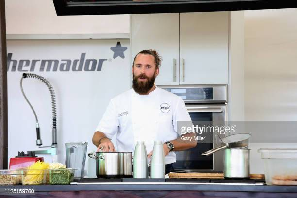 Chef Dylan Benoit gives a cooking demonstration during the sold out inaugural KAABOO Cayman Festival at Seven Mile Beach on February 15 2019 in Grand...