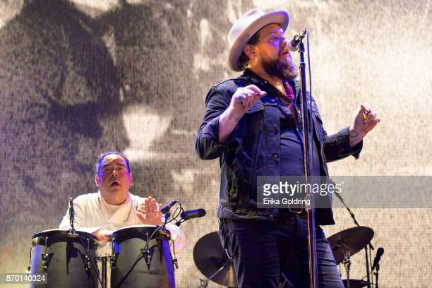 Chef Emeril Lagasse and Nathaniel Rateliff perform during 2017 Boudin Bourbon and Beer at Champions Square on November 3 2017 in New Orleans Louisiana