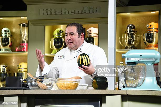 Chef Emeril Lagasse gives a cooking demonstration at the Grand Tasting presented by ShopRite featuring KitchenAid® culinary demonstrations presented...