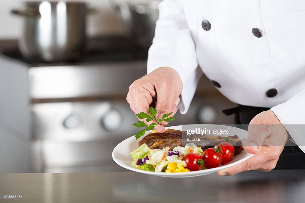 Chef finishing your plate : Stock Photo