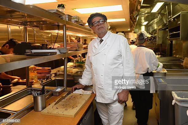 Chef Francis Mallmann prepares food at a Dinner Hosted By Francis Mallmann And Paul Qui during 2016 Food Network Cooking Channel South Beach Wine...