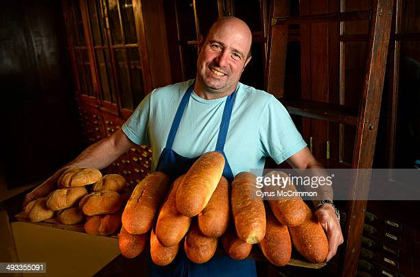 Chef Frank Bonanno holds a collection of Kaiser and grinder rolls for sandwiches. He is opening a new place in Highlands neighborhood of Denver...