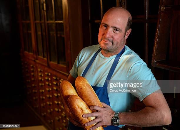 Chef Frank Bonanno holds grinder rolls for sandwiches. He is opening a new place in Highlands neighborhood of Denver called Salt & Grinder on...