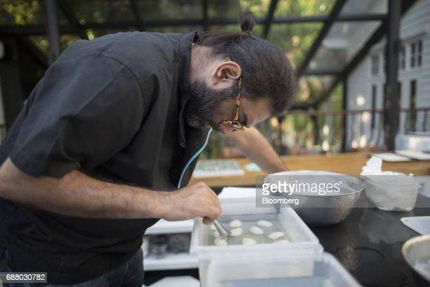 Chef Gaggan Anand prepares 'yogurt explosion' in the research and development kitchen at Gaggan restaurant in Bangkok Thailand on Friday May 5 2017...
