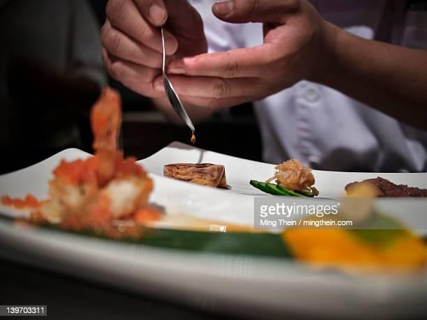 Chef garnishing modern cuisine
