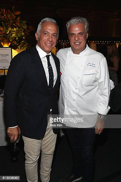 Chef Geoffrey Zakarian and Chef Eric Ripert attend City Harvest's 22nd Annual Bid Against Hunger at Pier 36 on October 6, 2016 in New York City.