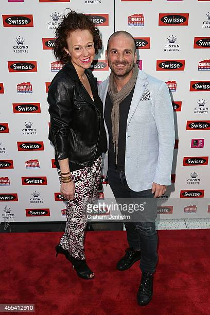 Chef George Calombaris and Natalie Tricarico pose on the red carpet prior to the Robbie Williams performance at the Palms at Crown on September 14...