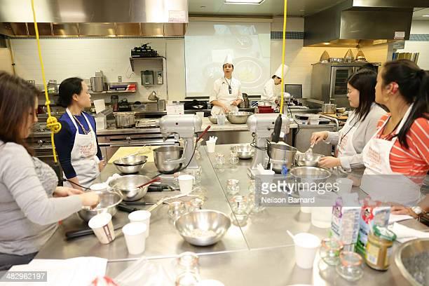 Chef Ghaya Oliveira prepares Coupe Mini Mac Chocolate Biscuit Macaron Praline Creme Bravaroise Meyer Lemon Marmalade Coupe Citronelle Lemongrass...