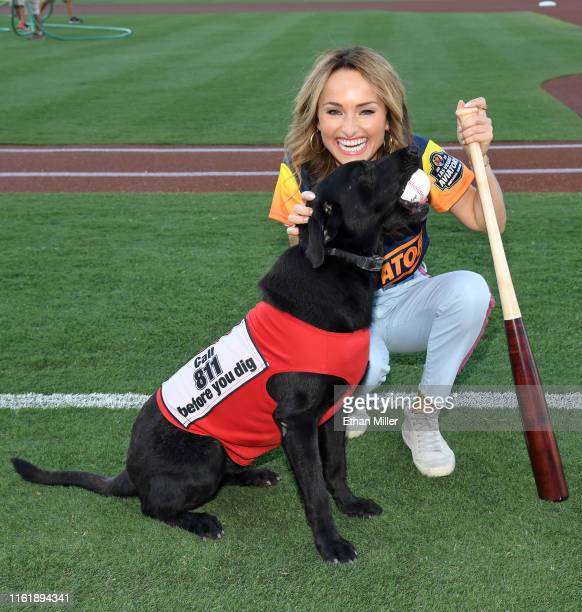 Chef Giada De Laurentiis greets Finn The Bat Dog on the field during her celebrity chef appearance at Las Vegas Ballpark on July 13, 2019 in Las...