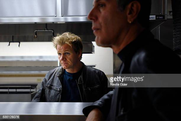 Chef Gordon Ramsay and food writer and chef Anthony Bourdain talk in the new kitchen of 'The London' Ramsey's new Manhatten restaurant 151 West 54th...