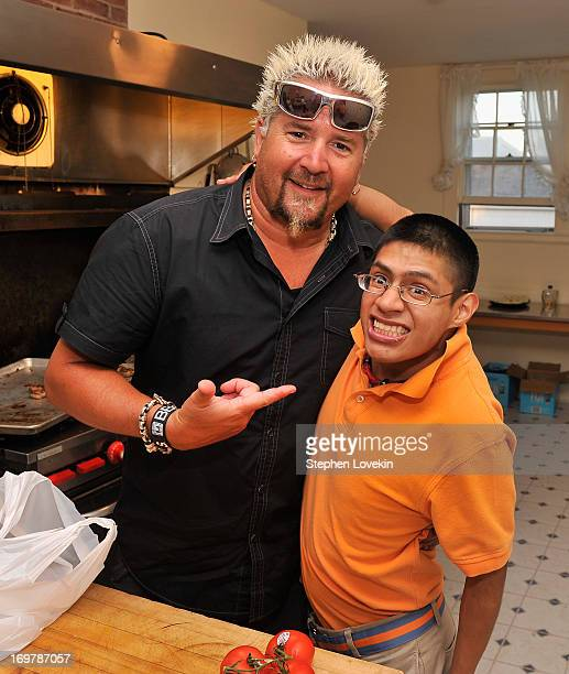 Chef Guy Fieri and Michael Jaxtimer Barry attend the Best Buddies Challenge Hyannis Port After Party on June 1 2013 in Hyannis Port Massachusetts