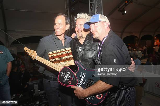Chef Guy Fieri presents prize to Hard Rock Fan Favorite winner on stage at Seminole Hard Rock Hotel Casino's Meatopia The Q Revolution presented by...