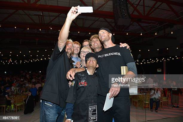Chef Guy Fieri takes a picture with Michael JaxtimeBarry Tom Brady John Hailer Joe Kennedy Joanne Jaxtimer and Anthony Shriver at the Tom Brady...