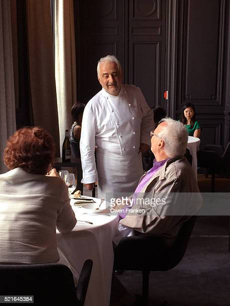 Chef Guy Savoy greeting and chatting with customers during a lunch