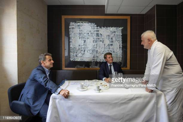 Chef Guy Savoy with Nicolas Sarkozy and Francois Baroin is photographed for Paris Match in his restaurant at the Monnaie de Paris on November 26,...