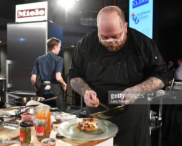 Chef Hamilton Johnson of Honeysuckle competes onstage at DC Central Kitchen's Capital Food Fight on November 16 2017 at the Ronald Reagan Building in...