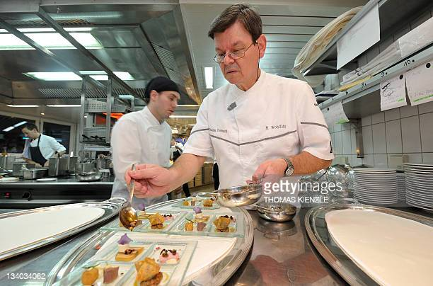 Chef Harald Wohlfahrt prepares the amuse gueules in the kitchen of his restaurant Schwarzwaldstube in the hotel Traube Tonbach in Baiersbronn in the...