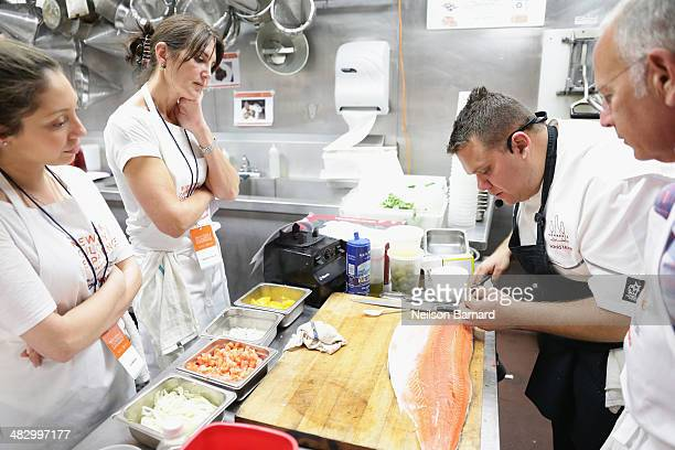 Chef Harold Moore of Commerce Restaurant prepares Striped Bass Crudo with Cerignola Olives, Fennel and Sweet Basil, Sour Dough Tartine with Burrata...