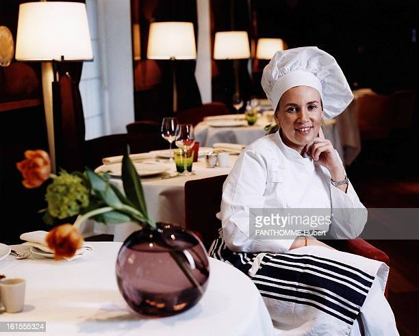 Chef Helene Darroze Helene DARROZE posing in apron and chef's hat has a table in his restaurant 'La maison d'Helene' in the heart of...