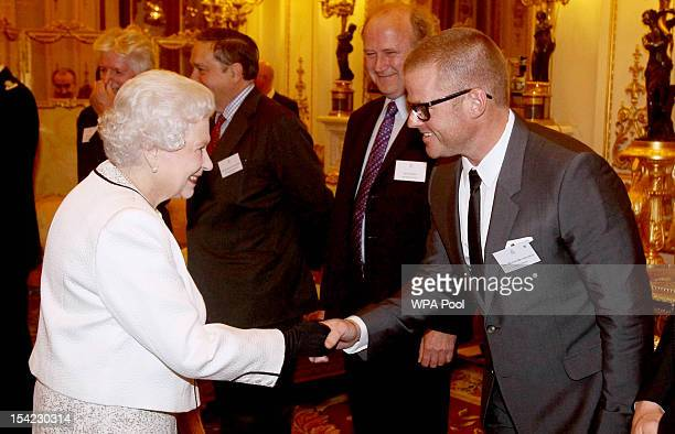 Chef Heston Blumenthal meets Queen Elizabeth II as he attends a reception at Buckingham Palace reception hosted by the Queen and Duke of Edinburgh...