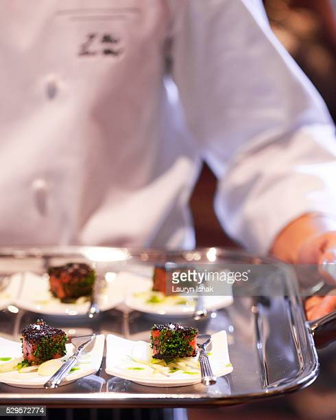 Chef holding a tray of dishes
