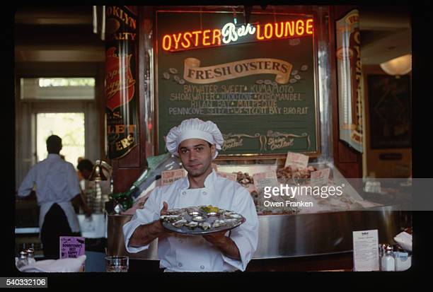 Chef Holding a Tray of Oysters