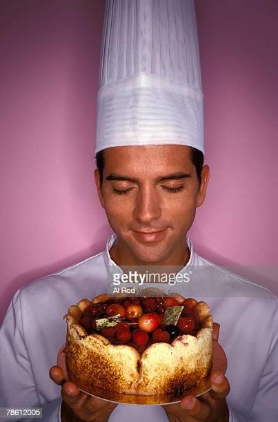 Chef holding fruit tart