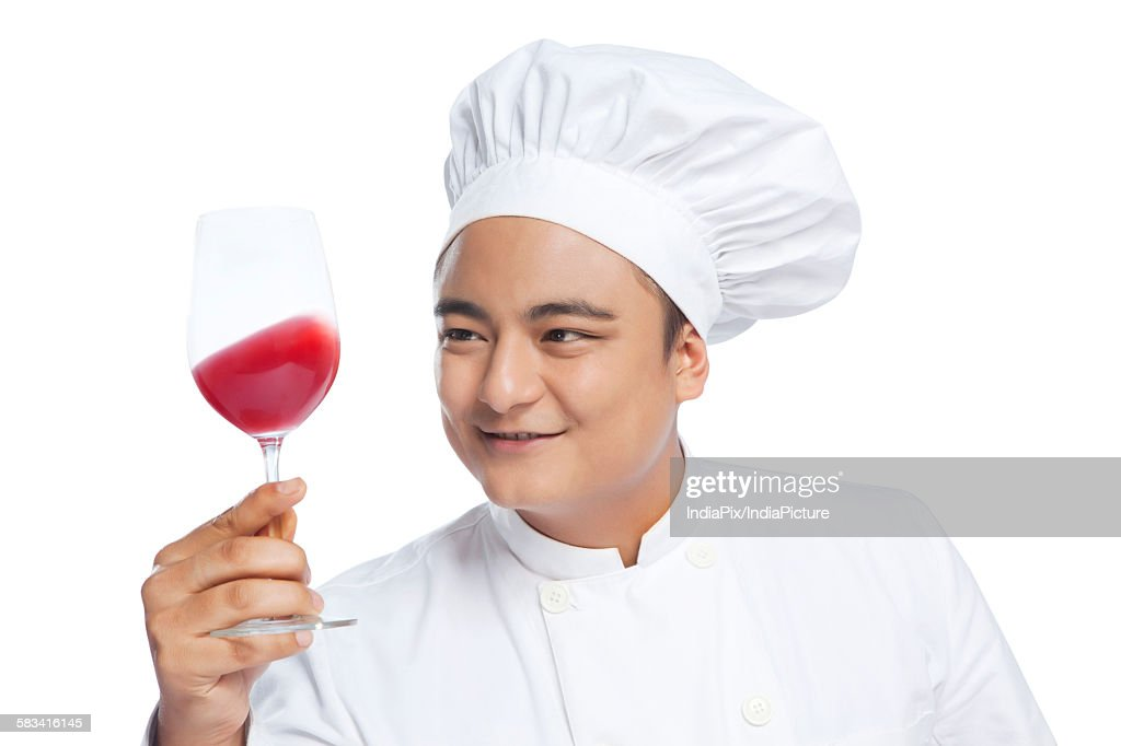 Chef holding glass with wine : Stock Photo