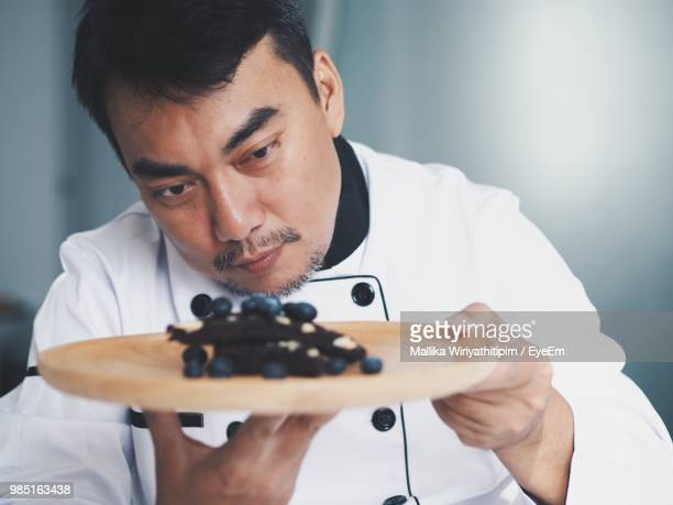 Chef Holding Plate With Sweet Food