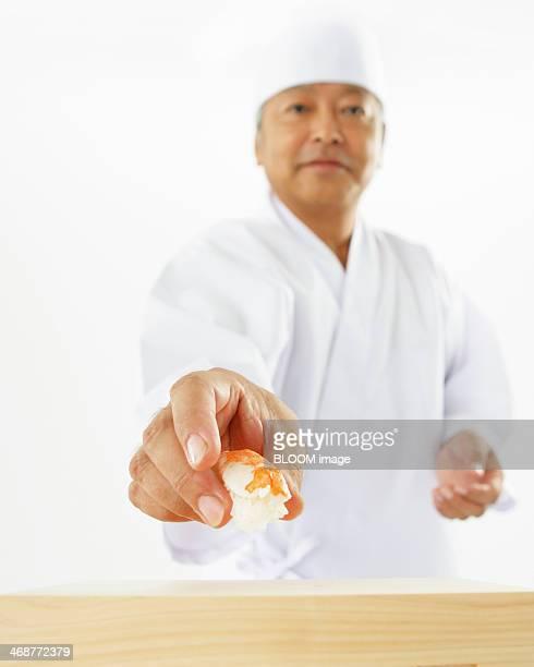 Chef Holding Sushi