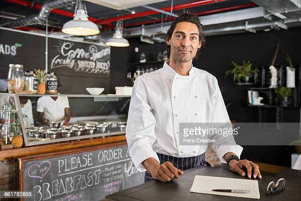 chef in restaurant looking at camera - restaurant manager stock pictures, royalty-free photos & images