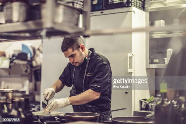 chef is working in an italian restaurant - food and drink industry stock photos and pictures