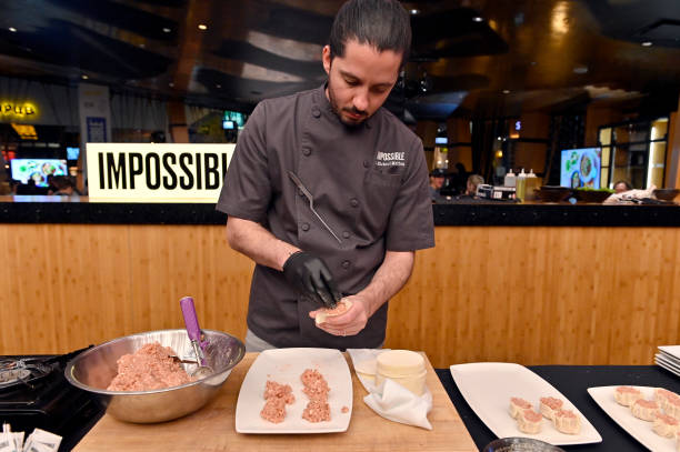 Chef J. Michael Melton prepares Pork Shumai made with Impossible Pork during an Impossible Foods press event for CES 2020 at the Mandalay Bay...