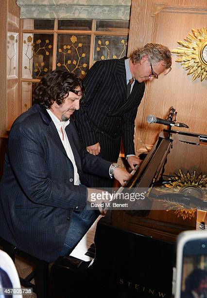 Chef Jay Rayner and Guy Chambers play the piano at Fortnum Mason's Diamond Jubilee Tea Salon for the launch of Tom Parker Bowles' new book 'Let's Eat...