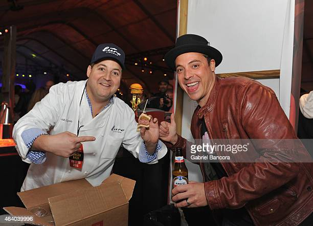 Chef Jeff Mauro and Chef Josh Capon enjoy a 95 calorie Official Beer of the Burger™ at Amstel Light Burger Bash hosted by Rachael Ray during the 2015...