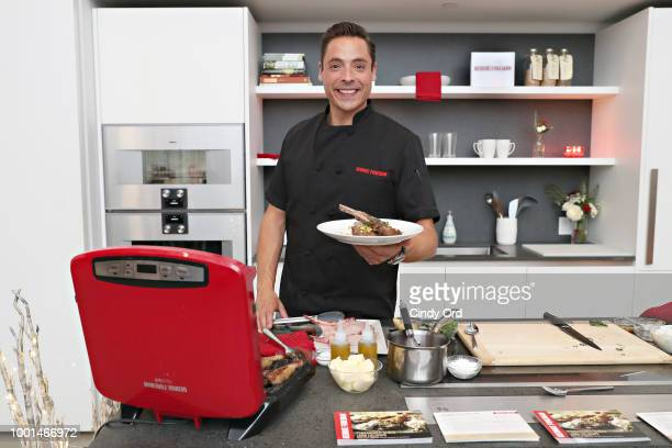 Chef Jeff Mauro cooks up a delicious holiday meal with the George Foreman 6Serving Rapid Series Grill at the brand's annual holiday showcase on July...