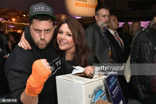 Chef Joe Isidori of Black Tap Burger and Host Rachael Ray attend the Food Network Cooking Channel New York City Wine Food Festival Presented By...