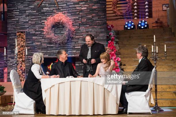 Chef Johann Lafer and hosts Joerg Pilawa and Francine Jordi are seen on stage during the New Year's Eve tv show hosted by Joerg Pilawa on December 30...