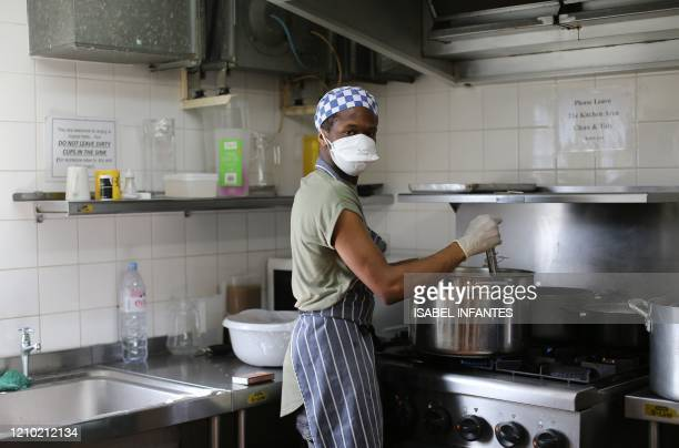 Chef Jojo Modest, made unemployed due to coronavirus crisis, and now working as a volunteer cooking food for people-in-need, to be delivered from St...